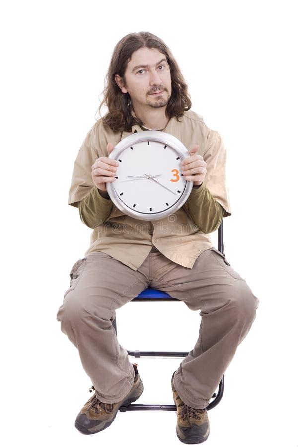 Uomo casuale che aspetta una riunione fotografia stock libera da diritti