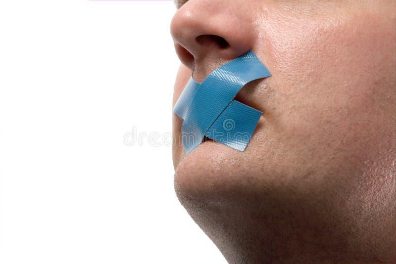 Uomo censurato con nastro adesivo blu fotografia stock