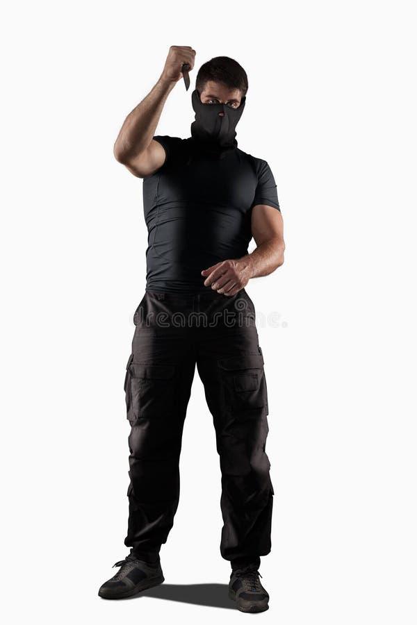 Uomo che atacking con il coltello isolato fotografia stock