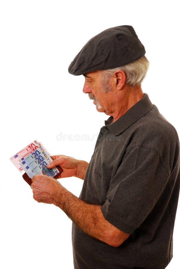 Uomo che conta gli euro fotografia stock libera da diritti