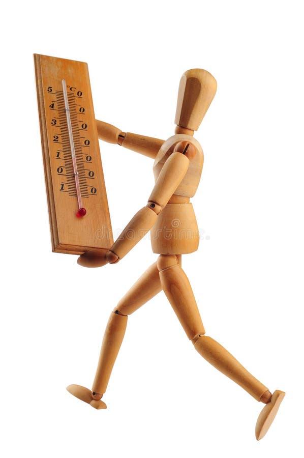 Uomo che funziona con il termometro fotografia stock libera da diritti