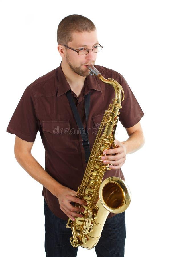 Uomo che gioca il sassofono immagini stock libere da diritti