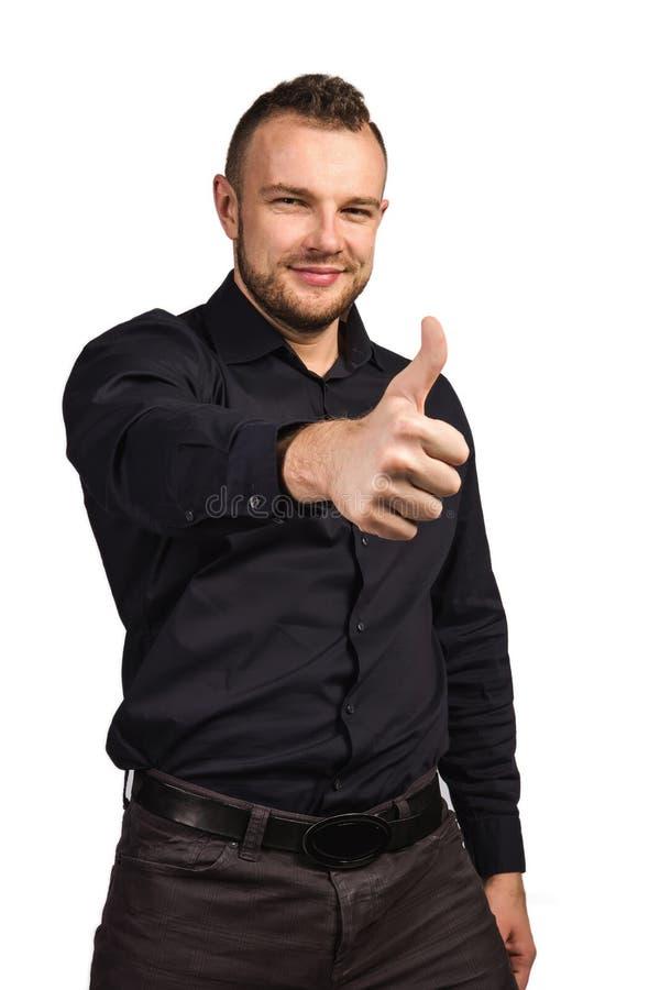 Uomo che mostra i pollici in su immagini stock