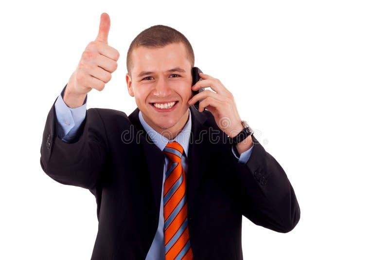 Uomo che mostra pollice in su sul telefono fotografia stock libera da diritti