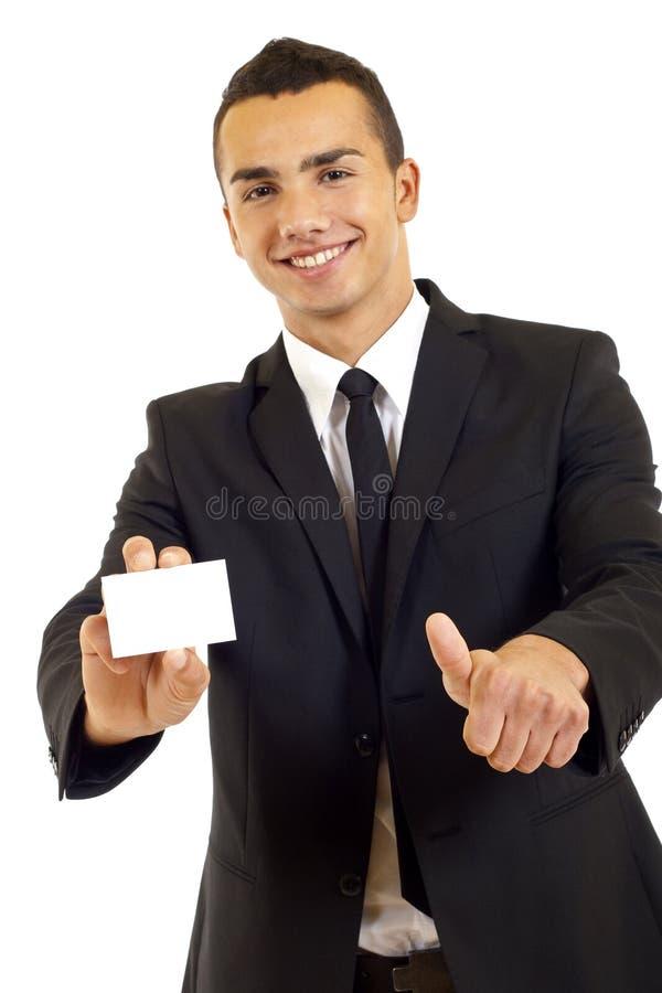 Uomo che mostra una scheda in bianco immagini stock libere da diritti