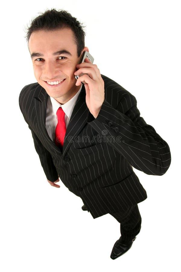 Uomo che per mezzo di un telefono mobile fotografia stock libera da diritti