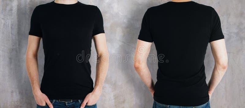Uomo che porta camicia nera fotografia stock