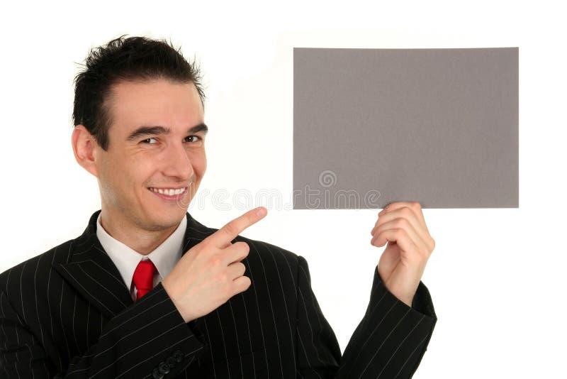 Uomo che tiene scheda in bianco fotografia stock