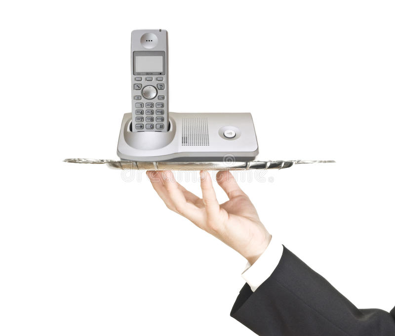 Uomo che tiene un cassetto d'argento con il telefono fotografie stock libere da diritti