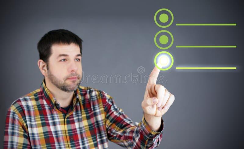 Uomo che tocca e che seleziona fotografie stock libere da diritti