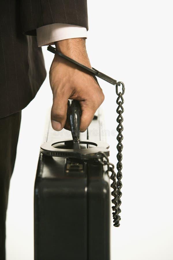 Uomo chiuso a chiave alla cartella immagini stock libere da diritti
