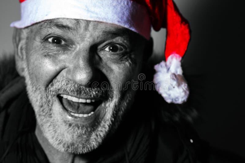Uomo con Babbo Natale che vista frontale, foto in bianco e nero, Natale sta arrivando fotografia stock libera da diritti