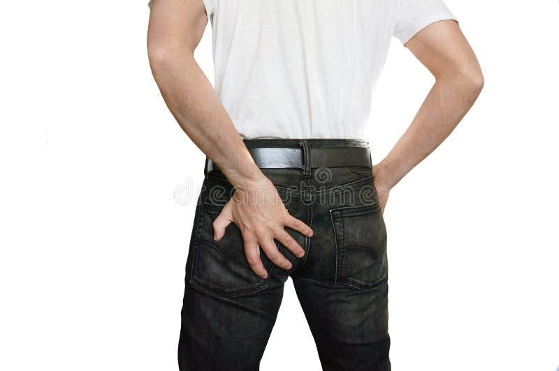 Uomo con gli emorroidi fotografie stock libere da diritti