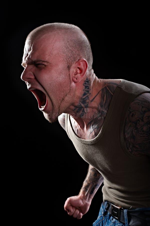 Uomo con i tatuaggi fotografie stock
