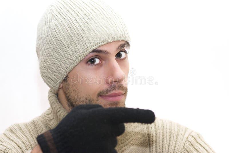 Uomo con il cappello che indica la destra immagini stock libere da diritti