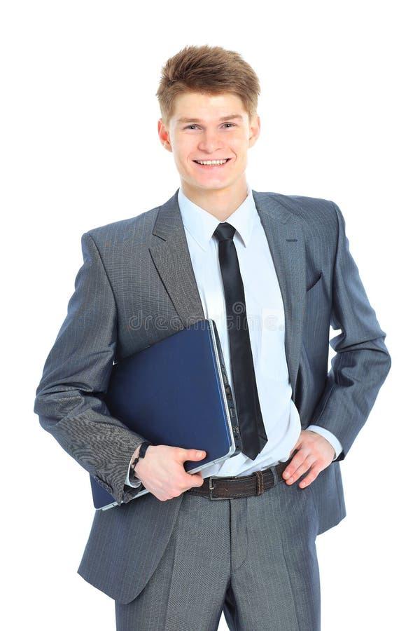 Uomo con il computer portatile su un fondo bianco immagini stock