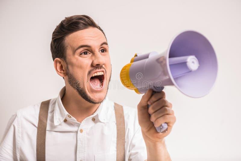 Uomo con il megafono fotografia stock libera da diritti