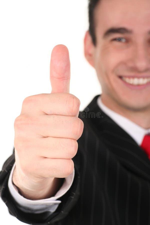 Uomo con il pollice in su fotografie stock