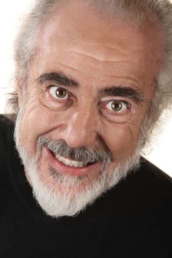 Uomo con il sorriso spaventoso immagini stock libere da diritti
