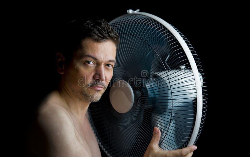 Uomo con il ventilatore immagini stock libere da diritti
