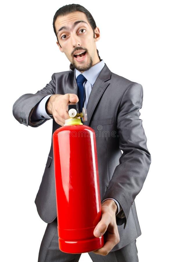 Uomo con l'estintore - concetto antincendio fotografie stock