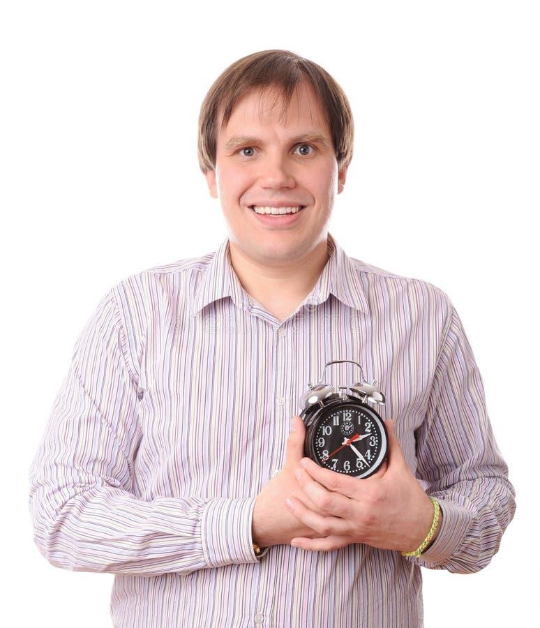 Uomo con l'orologio vicino a cuore immagine stock libera da diritti