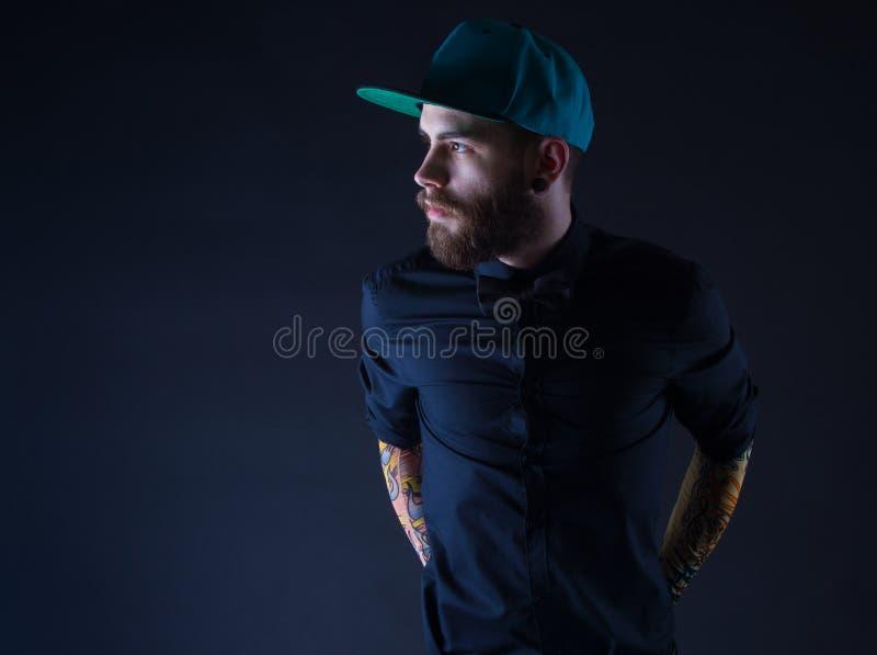 Uomo con la barba ed il cappello fotografie stock