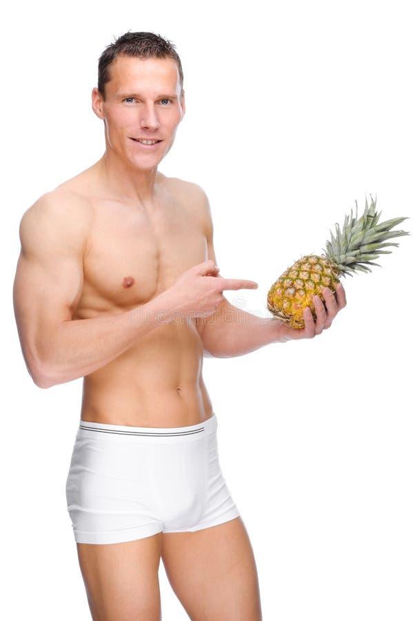 Uomo con la frutta immagini stock