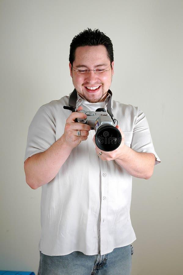 Uomo con la macchina fotografica immagini stock