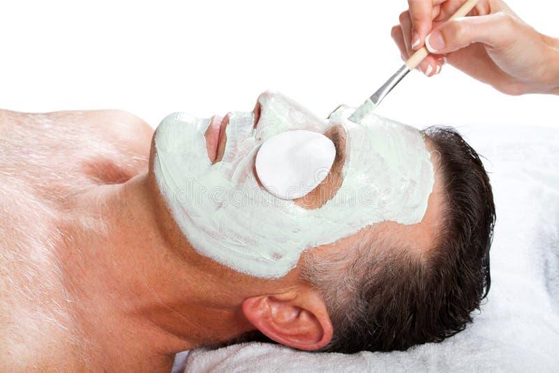 Uomo con la mascherina facciale fotografia stock libera da diritti