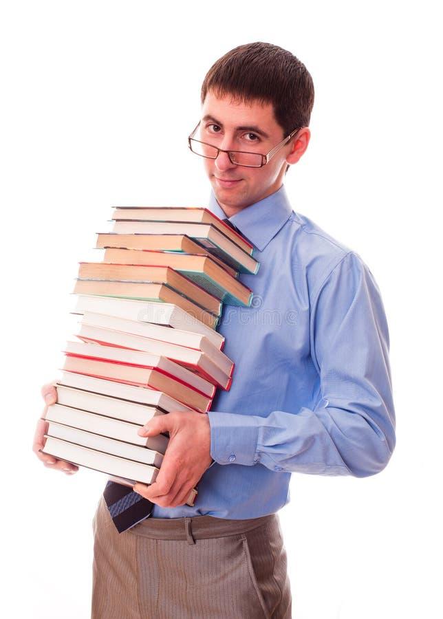 Uomo con la pila di libri immagine stock libera da diritti