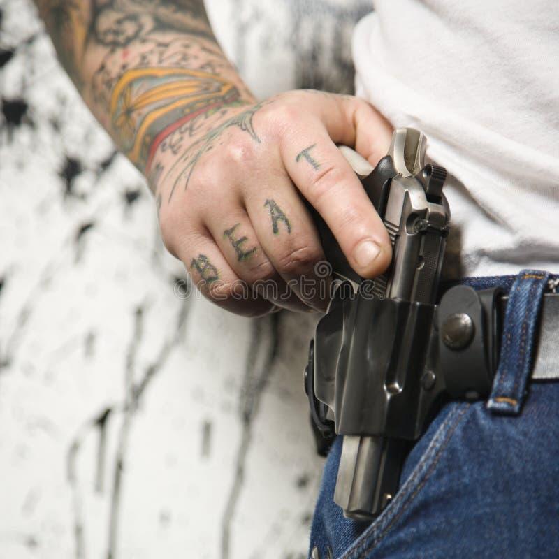 Uomo con la pistola. immagine stock libera da diritti