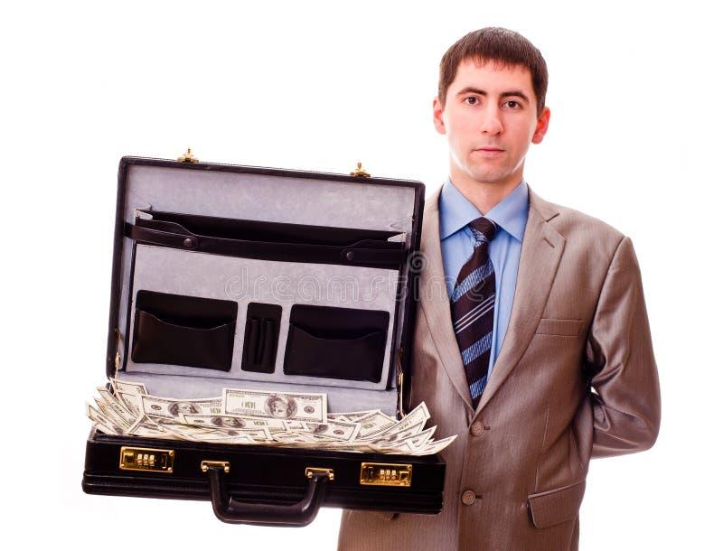 Uomo con la valigia piena di soldi fotografie stock