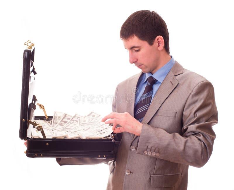 Uomo con la valigia piena di soldi immagini stock