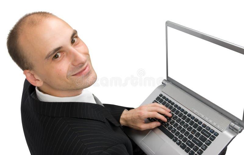 Uomo con un computer portatile immagine stock libera da diritti