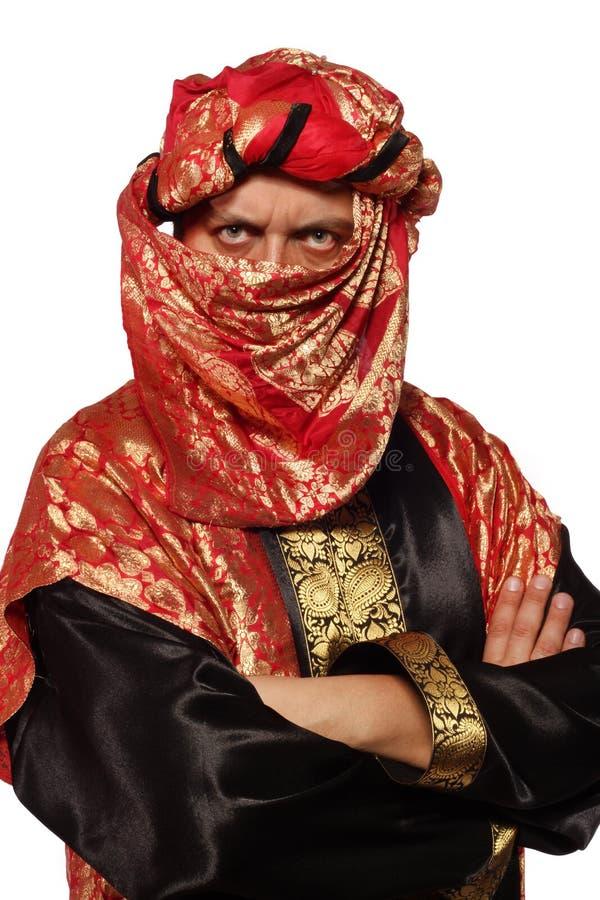 Uomo con un costume arabo. carnevale fotografia stock libera da diritti