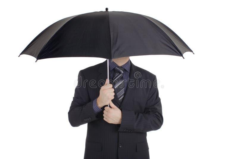 Uomo con un ombrello immagini stock