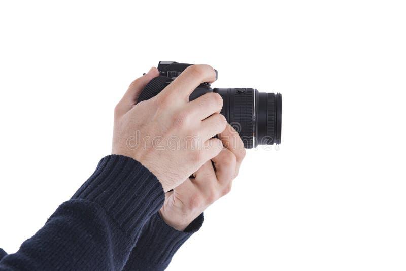 Uomo con una macchina fotografica di DSLR fotografie stock