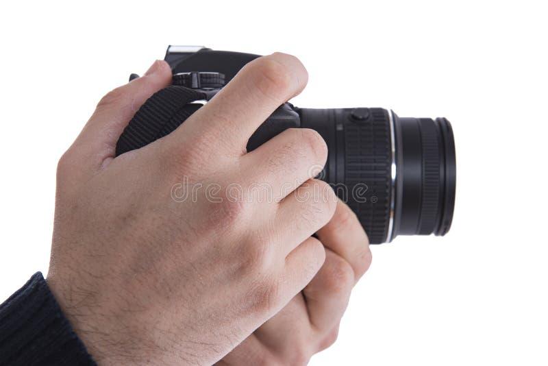 Uomo con una macchina fotografica di DSLR fotografie stock libere da diritti