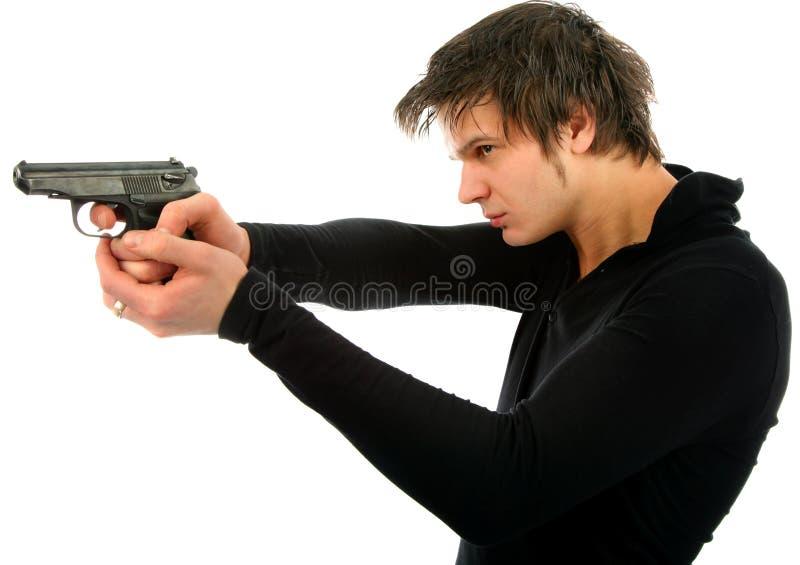 Uomo con una pistola immagini stock libere da diritti
