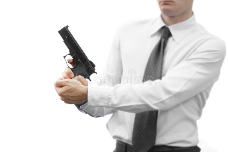 Uomo d'affari aggressivo con una pistola fotografie stock libere da diritti