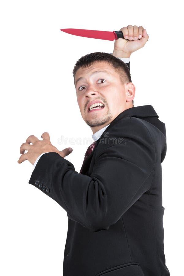 Uomo d'affari arrabbiato con un coltello immagini stock libere da diritti