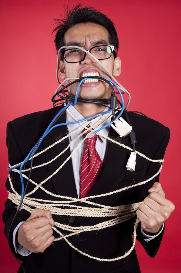 Uomo d'affari arrabbiato interamente legato in su fotografia stock