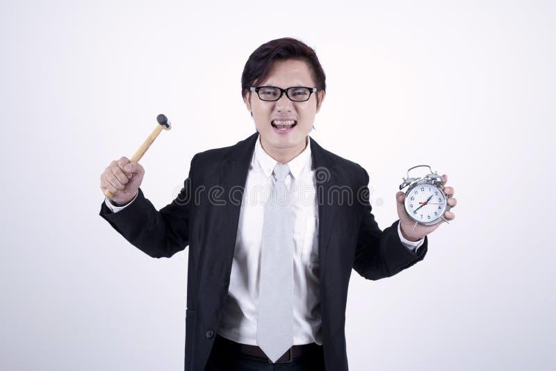 Uomo d'affari asiatico arrabbiato fotografia stock