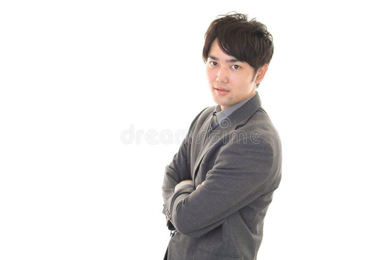 Download Uomo D'affari Asiatico Sorridente Fotografia Stock - Immagine di sfida, azienda: 56881140