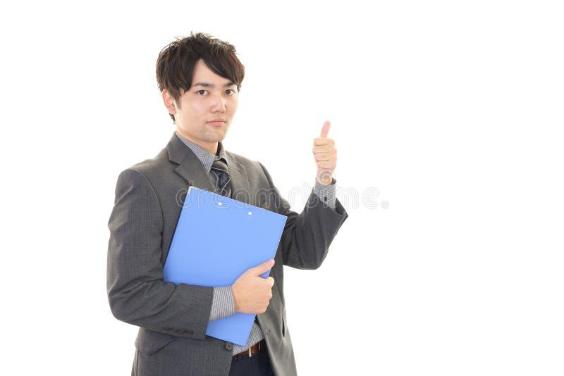 Download Uomo D'affari Asiatico Sorridente Immagine Stock - Immagine di eccitamento, corporativo: 56881821