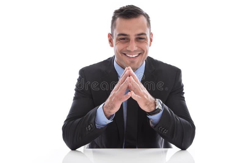 Uomo d'affari bello felice isolato in vestito. immagine stock