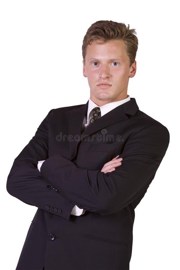 Uomo d'affari bene vestito con le braccia attraversate fotografia stock libera da diritti