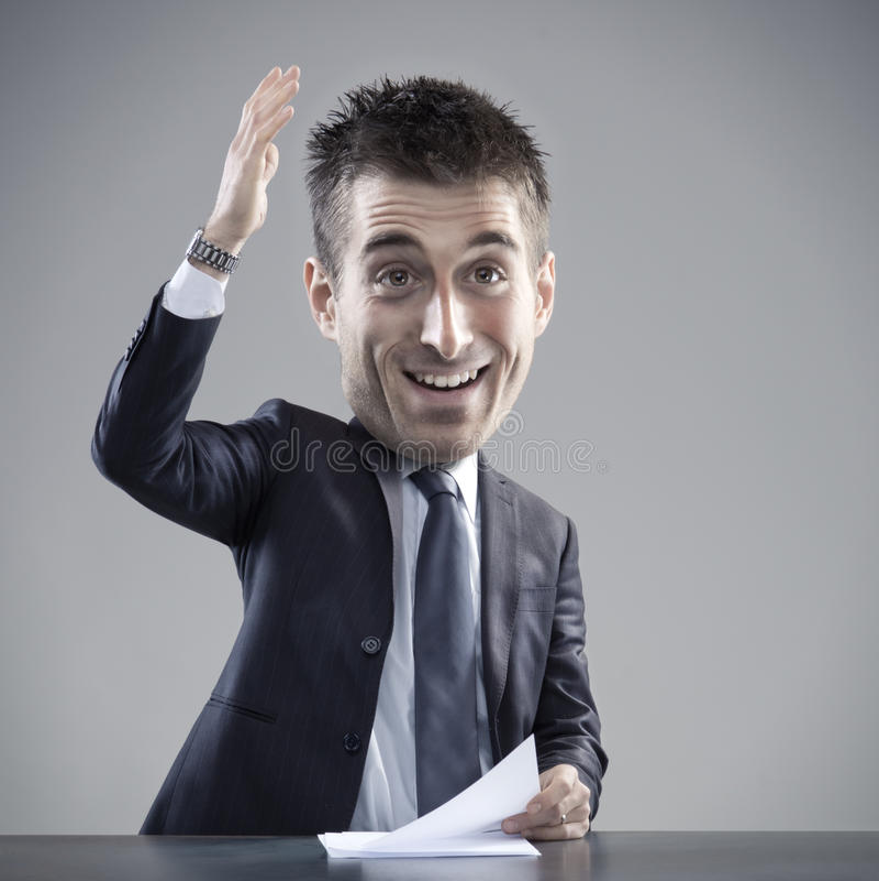 Uomo d'affari bizzarro che dà un discorso immagine stock libera da diritti