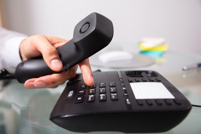 Uomo d'affari Calling On Landline fotografia stock